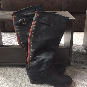 Black boots with red decoration and zippers